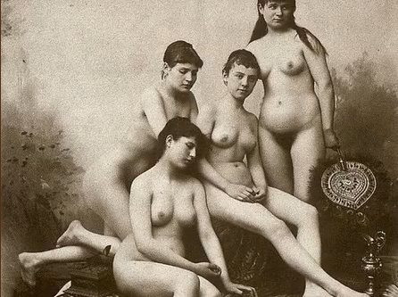This is an old black and white photo from the early 1900's of four nude young women.