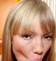 A blonde, Maya Hills, is sucking an unseen penis.