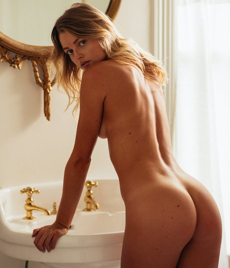 PLAYBOY Playmate Megan Samperi is naked seen from behind.