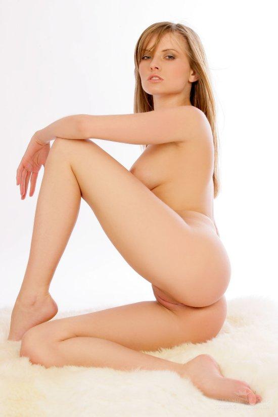 Nikky Case nude studio photo exposing her vagina