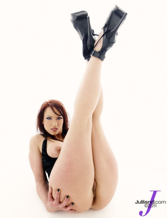 Naked leggy red head with her legs straight up