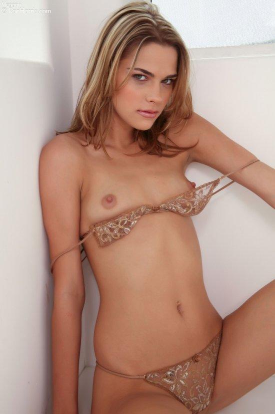 Meggan Malone pulls her bra exposing her breasts