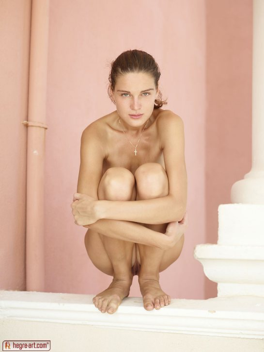 Zaika is a nude beauty squatting and showing her pussy.