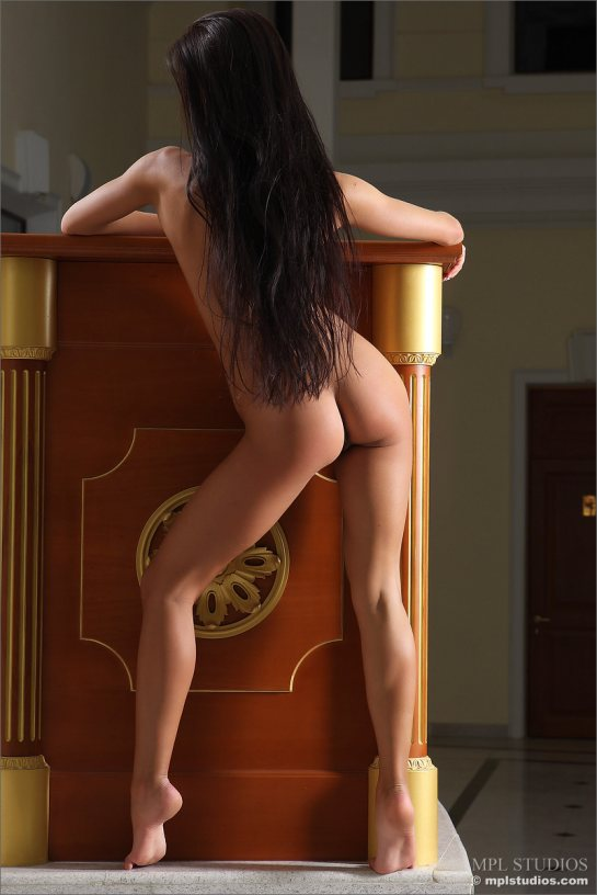Maria is seen from the rear standing naked showing her very long black hair and her naked butt.