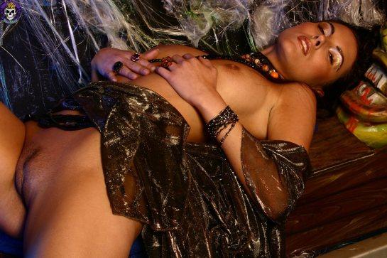 Zuzana lays naked with her eyes closed.