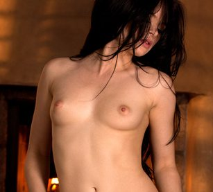 Topless brunette Jenna Ross is turning her head to the side.