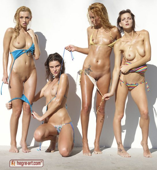 Four young women are pulling their bikinis off.