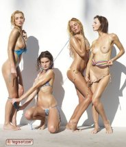 Four women are getting their bikinis pulled off.