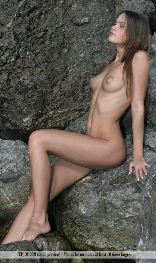 Lena is an auburn haired nude beauty.