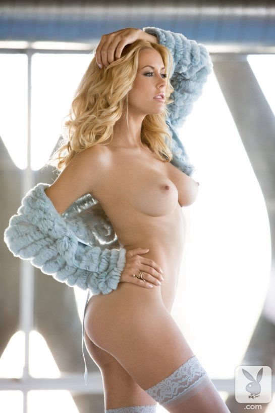 Kennedy Summers, Playboy's December 2013 Playmate, is standing nude.
