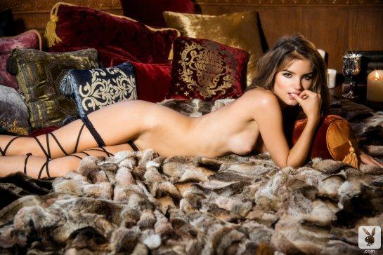 Roos Van Montfort, January 2014 Playboy Playmate is naked on her belly.