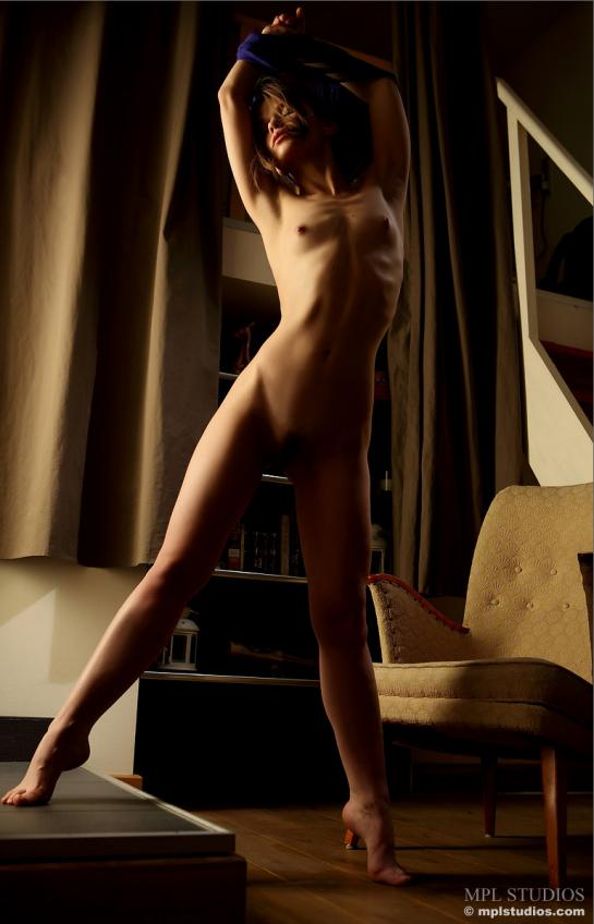 Nedda stretches and pulls off her top shows her naked tits and pubic hair.