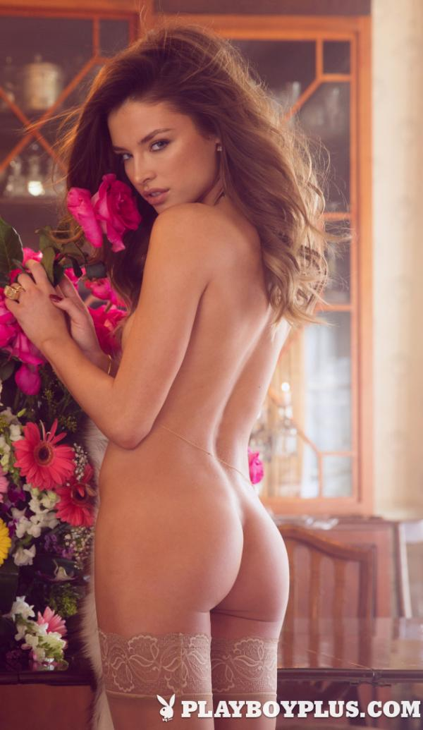 May 2015 Playboy Playmate Brittany Brousseau is wearing stockings and showing her naked butt.