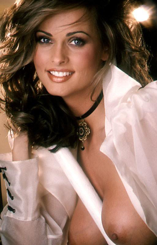 Karen McDougal's sheer blouse is opened and her full breasts are fully exposed showing both nipples. See every picture of Karen McDougal when you join PLAYBOY Archives.