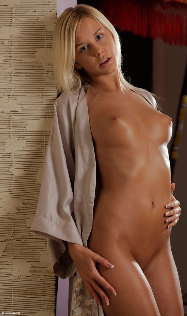 Susie is blonde, naked and tanned all over.