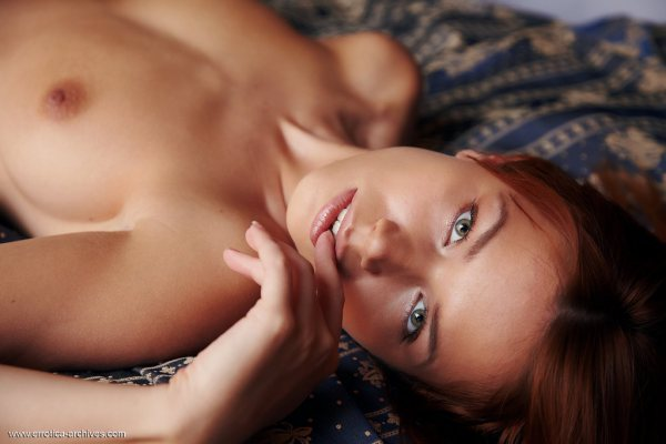 Beautiful redhead Kami is topless.