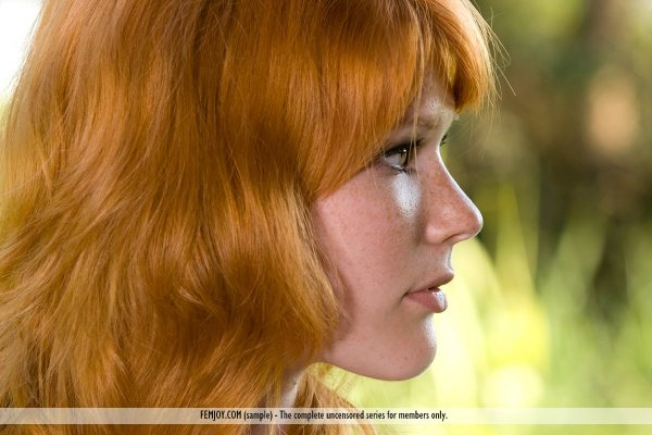 Redheaded Margy is seen in a close-up photo of her pretty face.
