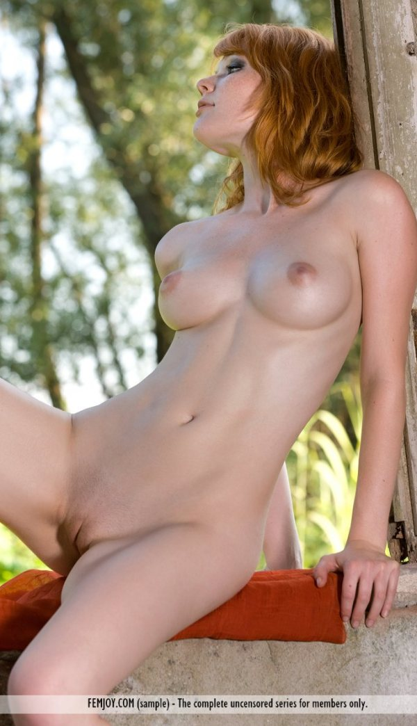 Margy is a very pretty completely nude redhead with full breasts.