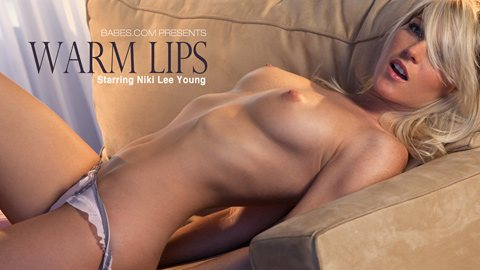 "Niki Lee Young is stretched out topless in her ""Warm Lips"" gallery cover photo."