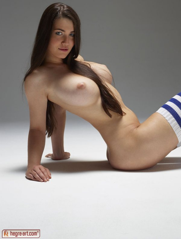 Long haired big breasted Yara is nude except for her thigh high socks.