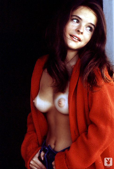 Pretty brunette Susan Bernard has her sweater open exposing her upturned breasts.