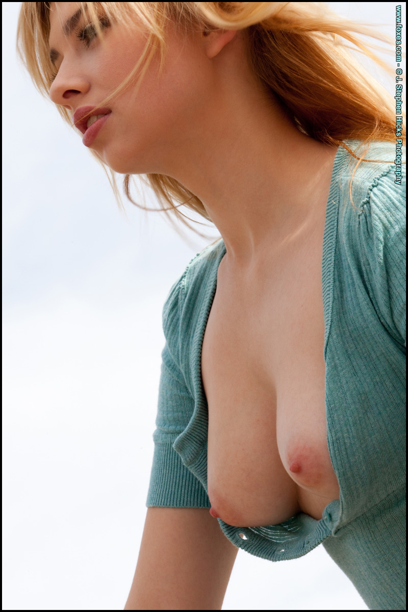 Molly Bennett is a cute strawberry blonde with her titties showing.
