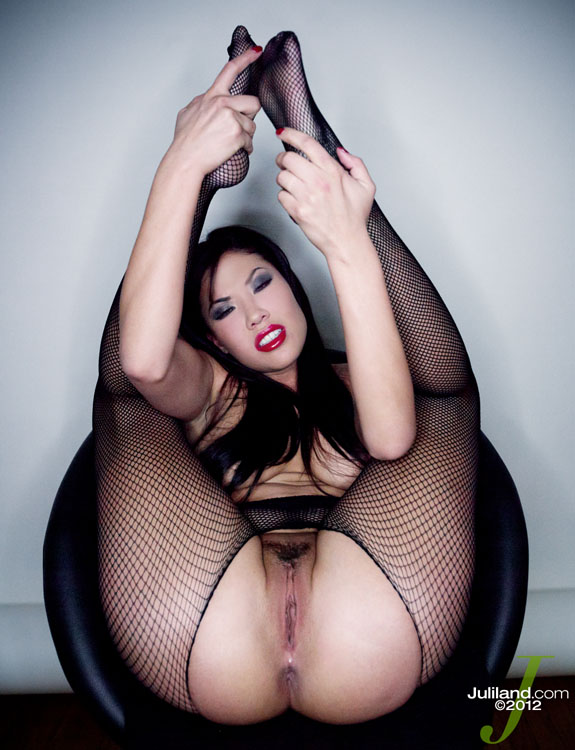 Dark haired London Keys wears crotchless mesh pantyhose as her legs are up in the air exposing her cunt.