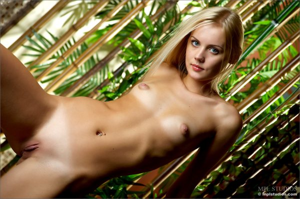 Pretty naked Sarah is showing her small breasts and her hairless pussy.