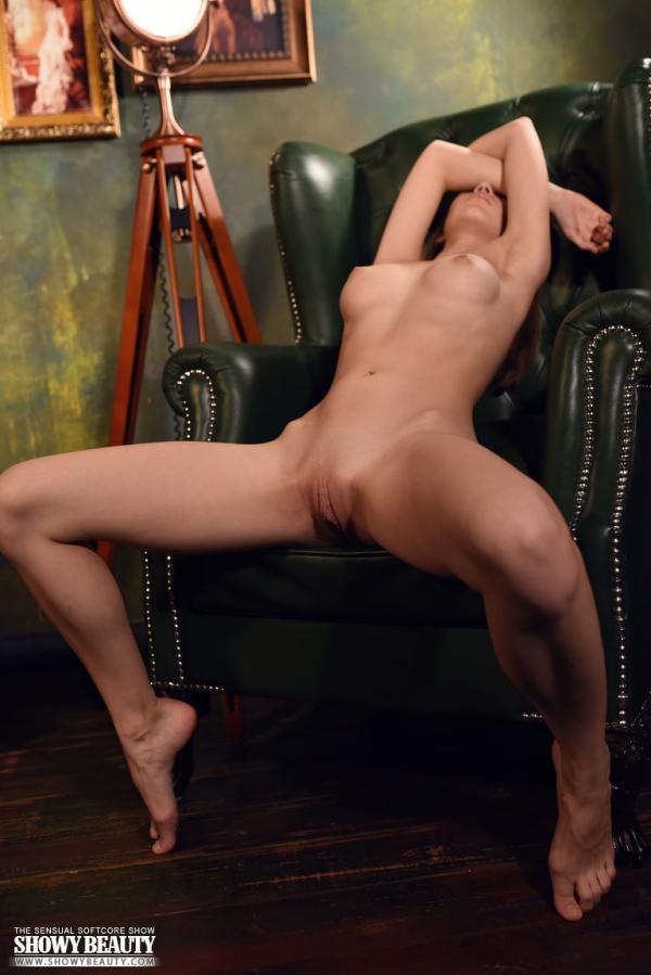 Lou spreads legs to show her totally nude beautiful body.
