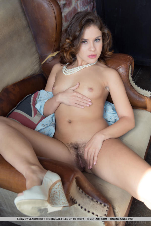 Pretty small breasted brunette Leda is showing her pussy hair.