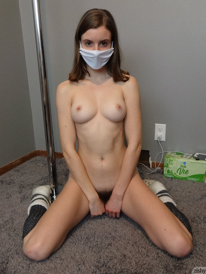 A masked big breasted brunette has bushy brown pubic hair.